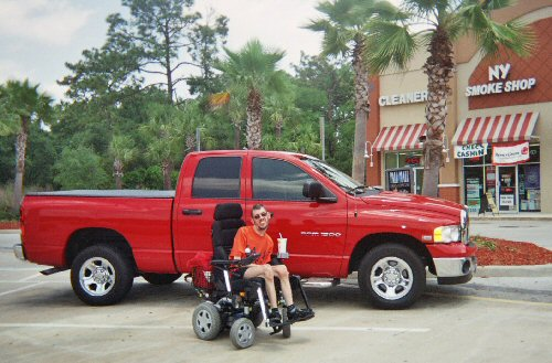 Me next to someone's huge pick-up truck in Orlando, Florida.